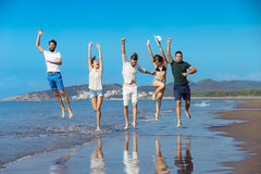 Friendship Freedom Beach Summer Holiday Concept - young people running royalty free stock images