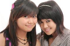 Friendship of girls. On white background Stock Photo