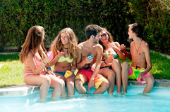 Friendship. Group of friends spending time together at the pool Royalty Free Stock Photography
