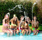 Friendship. Group of friends spending time together at the pool Stock Image