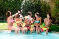 Friendship. Group of friends spending time together at the pool Stock Images
