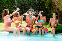 Friendship. Group of friends spending time together at the pool Stock Photo