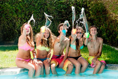 Friendship. Group of friends spending time together at the pool Stock Photography