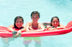 Friendship. Group of friends spending time together at the pool Royalty Free Stock Images