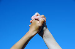 Friendship Hands. A background with a view of the joint hands of two friends Royalty Free Stock Photos
