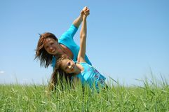 Friendship and happiness of mum and daughter. Friendship  happiness of mum and daughter against the blue sky Royalty Free Stock Photo