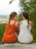 Friendship, happiness and people concept - two girls outdoor. Royalty Free Stock Image