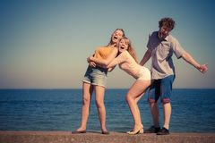 Group friends boy two girls having fun outdoor Royalty Free Stock Photos
