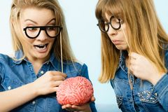 Two crazy women friends thinking Royalty Free Stock Image