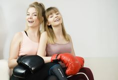 Two women friends wearing boxing gloves Royalty Free Stock Photos