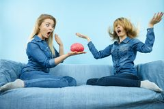 Two women friends thinking Royalty Free Stock Photos