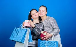 Friendship. Kid fashion. shop assistant with package. Sisterhood. Holiday purchases. Small girls with shopping bags. Sales and discounts. Happy children stock photos