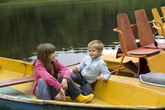 Friendship. kids playing in boat Royalty Free Stock Photos