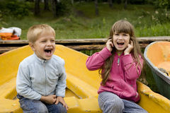 Friendship. kids playing in boat Stock Photo