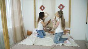 Friendship leisure joy pillow fight teen girls fun. Friendship leisure joy. pillow fight. young teen bff girls having fun stock video footage