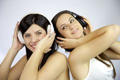 Friendship is listening music together Stock Photos
