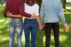 Friendship love jealousy adultery polygamy concept. Love triangle. Young women in relationship with two men Royalty Free Stock Photography