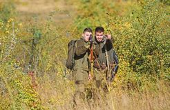Friendship of men hunters. Man hunters with rifle gun. Boot camp. Military uniform fashion. Army forces. Camouflage. Hunting skills and weapon equipment. How royalty free stock image
