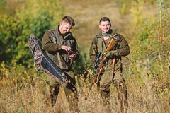 Friendship of men hunters. Man hunters with rifle gun. Boot camp. Military uniform fashion. Army forces. Camouflage. Hunting skills and weapon equipment stock photos