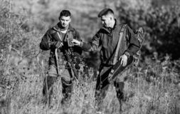 Friendship of men hunters. Military uniform fashion. Army forces. Camouflage. Hunting skills and weapon equipment. How. Turn hunting into hobby. Man hunters royalty free stock image