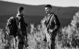 Friendship of men hunters. Military uniform fashion. Army forces. Camouflage. Hunting skills and weapon equipment. How. Turn hunting into hobby. Man hunters stock photography