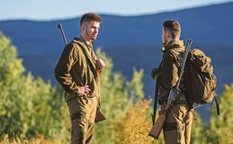 Friendship of men hunters. Military uniform fashion. Army forces. Camouflage. Hunting skills and weapon equipment. How. Turn hunting into hobby. Man hunters stock photo