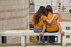 Friendship Nazareth. Two girls share a moment of friendship outside the Basilica of the Annunciation in Nazareth in northern Israel Stock Photo