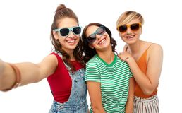 Happy female friends in sunglasses taking selfie Stock Images