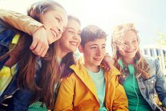 Happy teenage students or friends outdoors stock photo