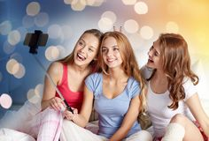 Teen girls with smartphone taking selfie at home royalty free stock images