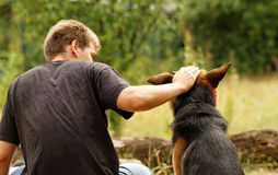 Friendship. Photo of a beautiful friendship with a boy and a dog Royalty Free Stock Photos