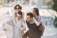 Young people walking in the city and having fun. Friendship, relationships, togetherness. Group of young people walking in the city and having fun Royalty Free Stock Images