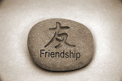 Friendship rock. Friendship stone sepia Stock Photo