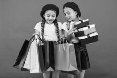 Friendship and sisterhood. International childrens day. Birthday and christmas presents. small girl children with. Shopping bags. big sale in shopping mall royalty free stock photography
