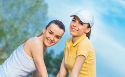 Friendship of smiling girl friends Stock Photography
