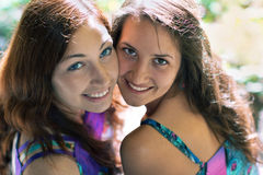 Friendship smiling two girls Royalty Free Stock Photography