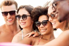 Close up of happy friends in sunglasses in summer stock photography