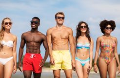Happy friends in sunglasses on summer beach royalty free stock photo