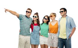 Friends in sunglasses over white background Stock Images