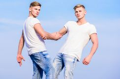 Friendship and support. Men muscular twins brothers in white shirts sky background. Brotherhood concept. Benefits and. Drawbacks of having identical twin stock photography