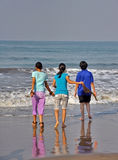 Friendship. Teenager friends enjoying vacation at sea beach Royalty Free Stock Photo