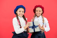 Friendship is their real present. Small children holding birthday present on pink background. Little girls smiling with. Wrapped present box. Happy kids stock photos
