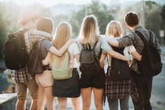 Happy young people hugging looking at city view royalty free stock images