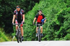 Friendship and travel on mountain bike Stock Photos