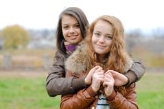 Friendship - Two best girlfriends hugging eachother Royalty Free Stock Images