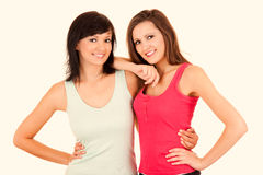 Friendship - Two girlfriends hugging each other, white backgroun Stock Photos