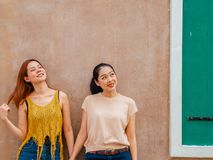 Friendship of two woman standing outdoor. Friendship of two Asian women standing outdoor. laughing youth portrait women ethnic fashion young cheerful background stock photos
