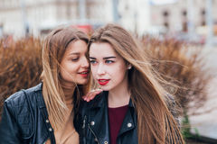 Friendship . Two Women Talking in the City Stock Photo