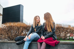 Friendship . Two Women Talking in the City Royalty Free Stock Images