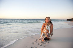 Friendship of woman and dog at Ocean Royalty Free Stock Photo